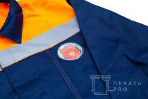 Синие рабочие куртки с оранжевыми вставками с логотипом «ГАРАНТСПАС»
