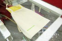 Бежевые промо сумки с надписью «благотворительная программа 'справедливая помощь'»