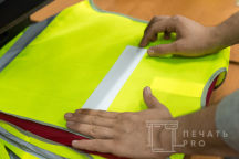 Желтые сигнальных жилеты с логотипом «Спецстроймонтаж»